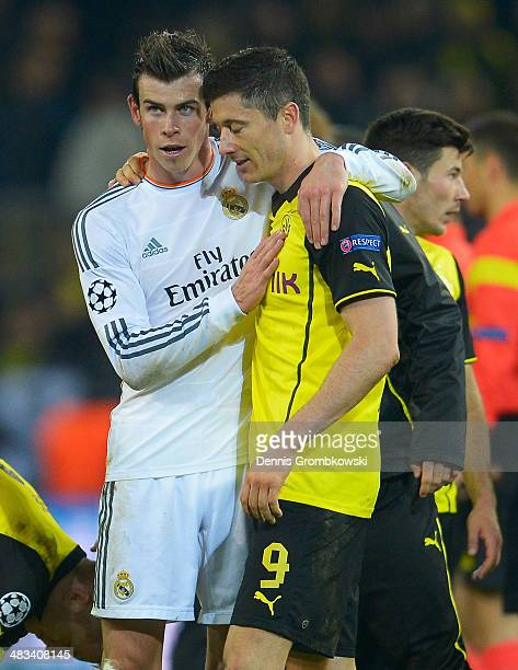 Gareth Bale of Real Madrid consoles Robert Lewandowski of Borussia Dortmund after the UEFA Champions League Quarter Final second leg match between...