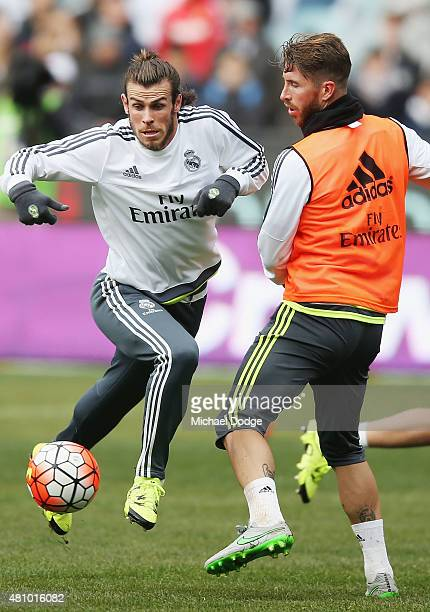 Gareth Bale of Real Madrid contests for the ball against Sergio Ramos during a Real Madrid training session at Melbourne Cricket Ground on July 17...