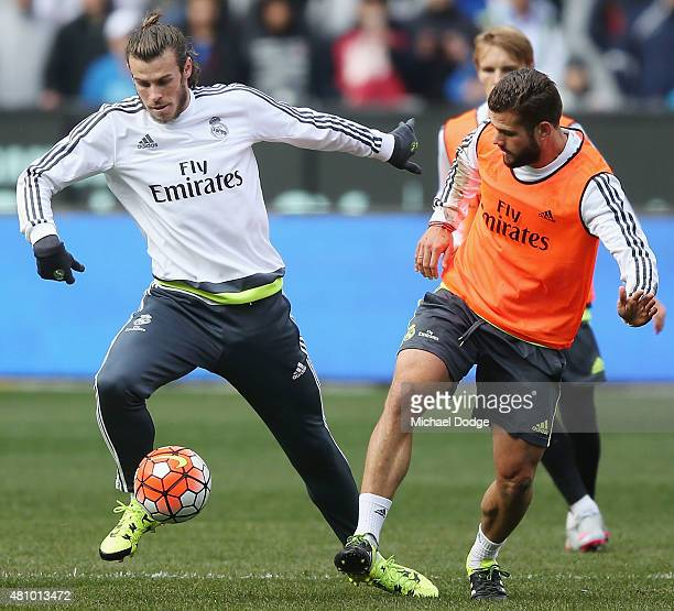 Gareth Bale of Real Madrid controls the ball against Nacho Fernandez of Real Madrid during a Real Madrid training session at Melbourne Cricket Ground...
