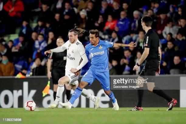Gareth Bale of Real Madrid Damian Suarez of Getafe CF during the La Liga Santander match between Getafe v Real Madrid at the Coliseum Alfonso Perez...