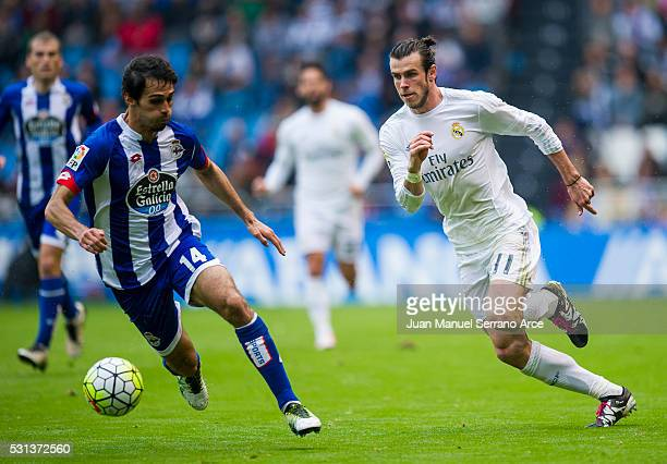 Gareth Bale of Real Madrid duels for the ball with Alejandro Arribas of RC Deportivo La Coruna during the La Liga match between RC Deportivo La...