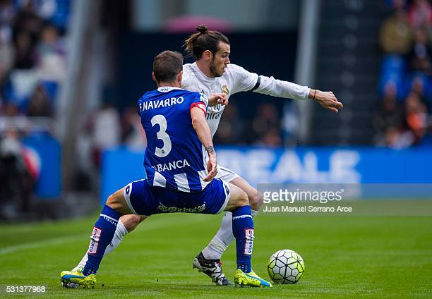 Gareth Bale of Real Madrid duels for the ball with Fernando Navarro of RC Deportivo La Coruna during the La Liga match between RC Deportivo La Coruna...