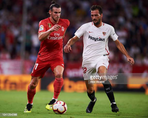 Gareth Bale of Real Madrid duels for the ball with Franco Vazquez of Sevilla FC during the La Liga match between Sevilla FC and Real Madrid CF at...