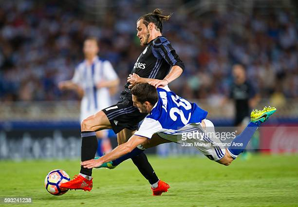 Gareth Bale of Real Madrid duels for the ball with Joseba Zaldua of Real Sociedad during the La Liga match between Real Sociedad de Futbol and Real...
