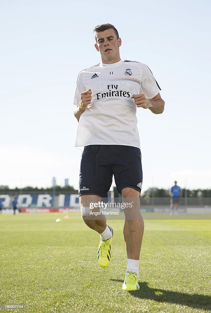 Gareth Bale of Real Madrid exercises during his first training session with the team at Valdebebas training ground on September 11, 2013 in Madrid, Spain.