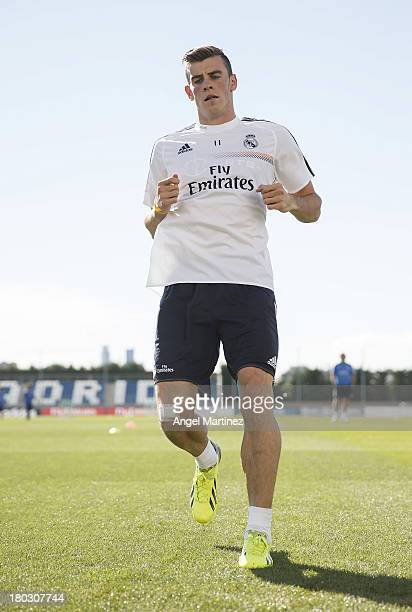 Gareth Bale of Real Madrid exercises during his first training session with the team at Valdebebas training ground on September 11, 2013 in Madrid,...