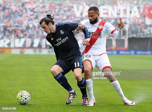 Gareth Bale of Real Madrid fends off Tiago Manuel Dias Correia ''Bebe'' of Rayo Vallecano de Madrid during the La Liga match between Rayo Vallecano...