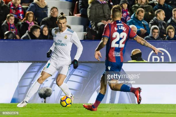 Gareth Bale of Real Madrid fights for the ball with Antonio Manuel Luna Rodriguez of Levante UD during the La Liga 201718 match between Levante UD...