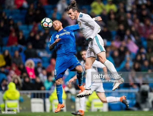 Gareth Bale of Real Madrid fights for the ball with Vitorino Gabriel Pacheco Antunes of Getafe CF during the La Liga match between Real Madrid and...
