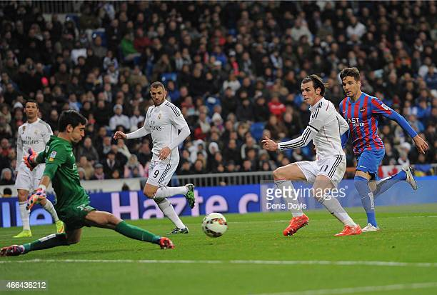 Gareth Bale of Real Madrid gets his shot at goal blocked by Diego Marino of Levante during the La Liga match between Real Madrid CF and Levante UD at...