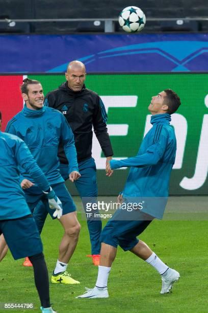 Gareth Bale of Real Madrid Head coach Zinedine Zidane of Real Madrid and Cristiano Ronaldo of Real Madrid controls the ball during a Real Madrid...