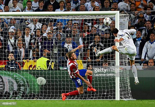 Gareth Bale of Real Madrid heads in their second goal during the UEFA Champions League Final between Real Madrid and Atletico de Madrid at Estadio da...