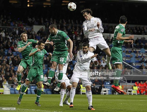 Gareth Bale of Real Madrid heads the ball during the UEFA Champions League Group B match between Real Madrid CF and PFC Ludogorets Razgrad at Estadio...