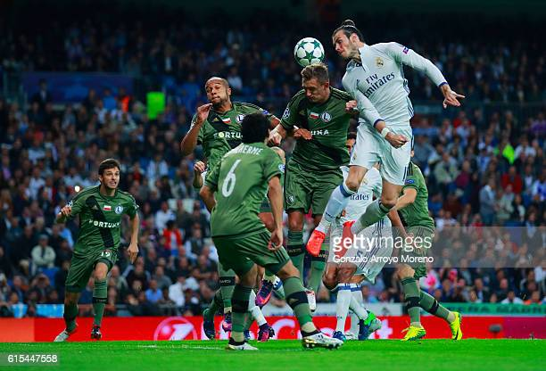 Gareth Bale of Real Madrid heads the ball during the UEFA Champions League Group F match between Real Madrid CF and Legia Warszawa at Bernabeu on...