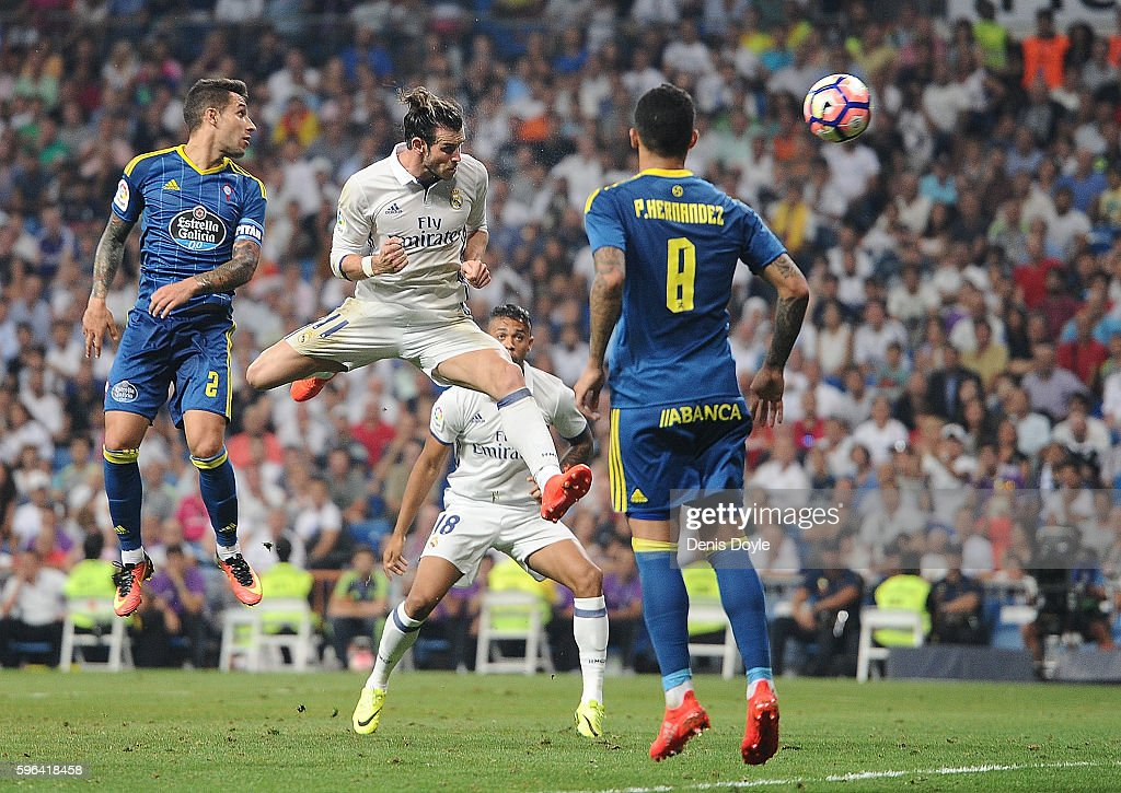 Gareth Bale Of Real Madrid Heads The Ball Past Pablo Hernandez Of Celta De Vigo During