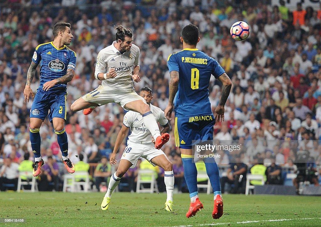 Gareth Bale of Real Madrid heads the ball past Pablo Hernandez of Celta de Vigo during the La Liga match between Real Madrid CF and RC Celta de Vigo at Estadio Santiago Bernabeu on August 27, 2016 in Madrid, Spain.