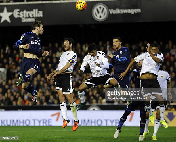 Gareth Bale of Real Madrid heads the ball to score his team's second goal during the La Liga match between Valencia CF and Real Madrid CF at Estadio...