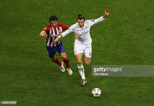Gareth Bale of Real Madrid holds off Stefan Savic of Atletico Madrid during the UEFA Champions League Final match between Real Madrid and Club...