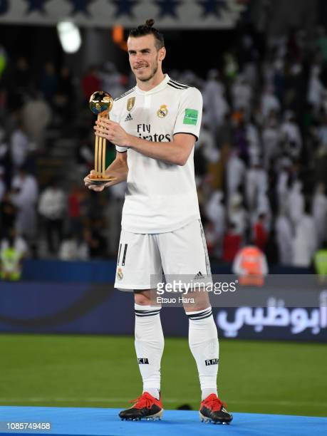 Gareth Bale of Real Madrid holds the Adidas golden ball trophy during the medal ceremony after the match between Real Madrid and Al Ain on December...