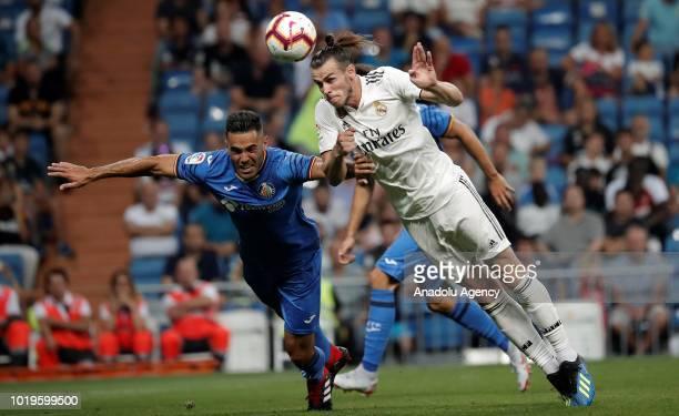 Gareth Bale of Real Madrid in action against Bruno of Getafe during La Liga soccer match between Real Madrid and Getafe at Santiago Bernabeu Stadium...