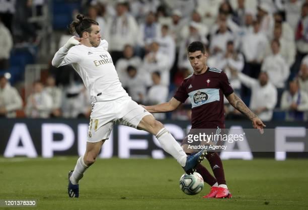 Gareth Bale of Real Madrid in action against Lucas Olaza of Celta Vigo during La Liga soccer match between Real Madrid and Celta Vigo at Santiago...