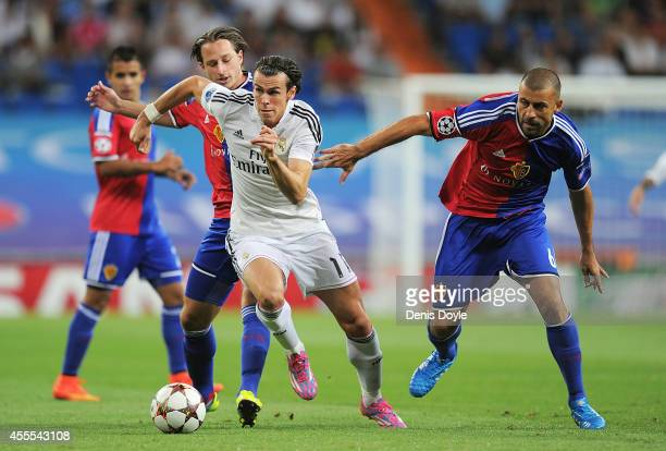 Gareth Bale of Real Madrid in action against Walter Samuel of FC Basel 1893 during the UEFA Champions League Group B match between Real Madrid CF and...