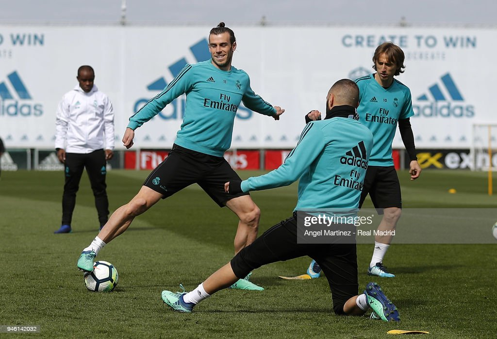 Gareth Bale (L) of Real Madrid in action during a training session at Valdebebas training ground on April 14, 2018 in Madrid, Spain.