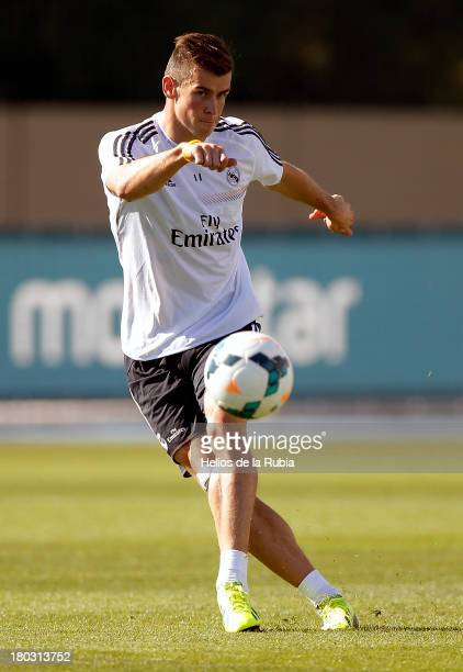 Gareth Bale of Real Madrid in action during his first training session with the team at Valdebebas training ground on September 11, 2013 in Madrid,...