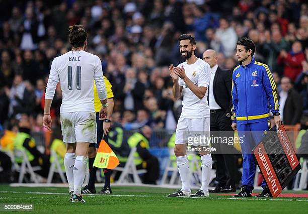 Gareth Bale of Real Madrid is applauded by Alvaro Arbeloa after he scored 4 goals and was then substitutes during the La Liga match between Real...