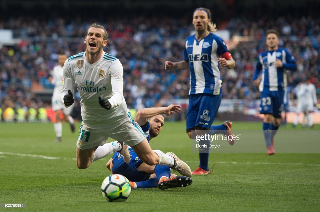 Gareth Bale of Real Madrid is brought down by Victor Laguardia of Deportivo Alaves during the La Liga match between Real Madrid and Deportivo Alaves at Estadio Santiago Bernabeu on February 24, 2018 in Madrid, Spain. Real were awarded a penalty kick which was converted by Karim Benzema for their 4th goal.