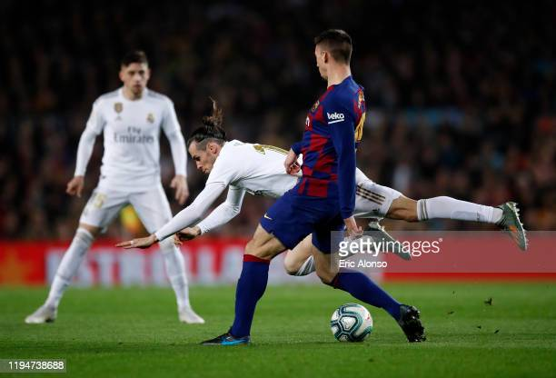 Gareth Bale of Real Madrid is challenged by Clement Lenglet of Barcelona during the Liga match between FC Barcelona and Real Madrid CF at Camp Nou on...