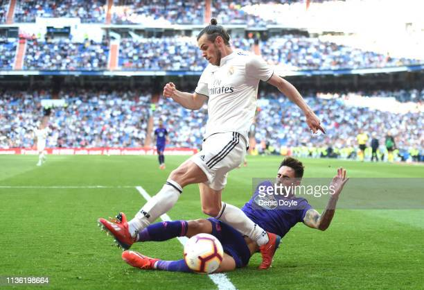 Gareth Bale of Real Madrid is challenged by David Costas of Celta Vigo during the La Liga match between Real Madrid CF and RC Celta de Vigo at...