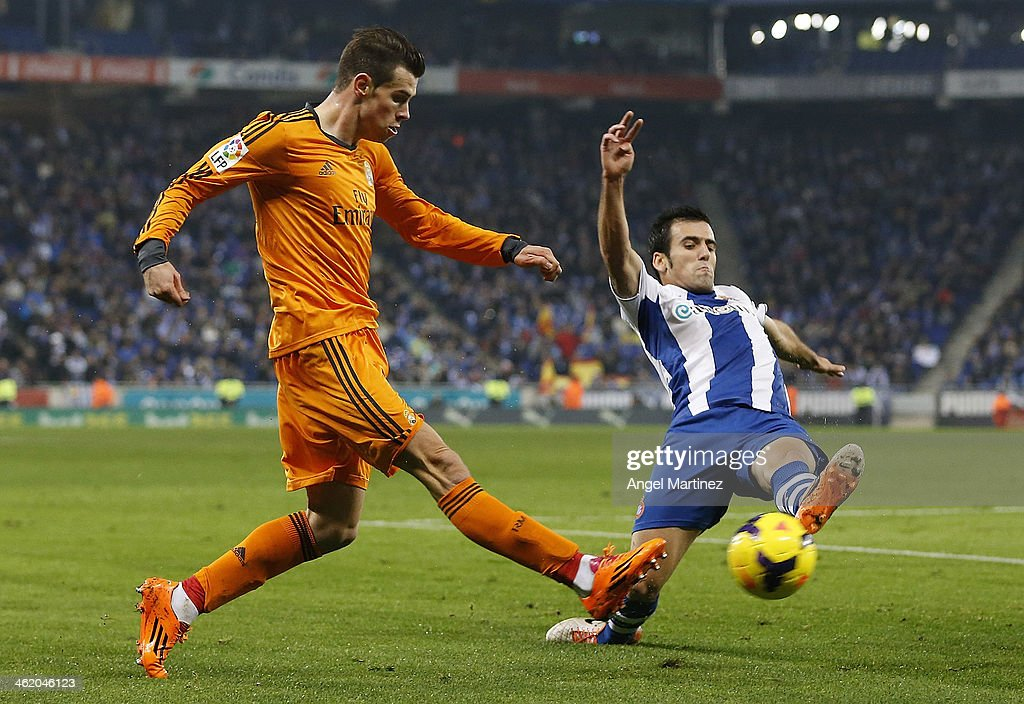 Gareth Bale of Real Madrid is challenged by Juan Fuentes of Espanyol during the La Liga match between RCD Espanyol and Real Madrid at Cornella-El Prat Stadium on January 12, 2014 in Barcelona, Spain.