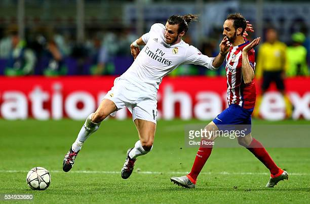 Gareth Bale of Real Madrid is challenged by Juanfran of Atletico Madrid during the UEFA Champions League Final match between Real Madrid and Club...