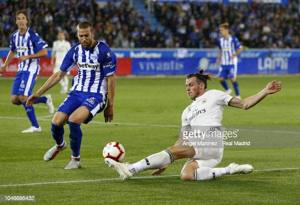 Gareth Bale of Real Madrid is challenged by Victor Laguardia of Deportivo Alaves during the La Liga match between Deportivo Alaves and Real Madrid at...