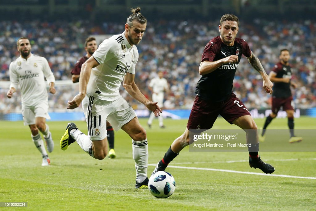 Gareth Bale of Real Madrid is chased by Davide Calabria of AC Milan during the Trofeo Santiago Bernabeu match between Real Madrid and AC Milan at Estadio Santiago Bernabeu on August 11, 2018 in Madrid, Spain.
