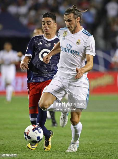 Gareth Bale of Real Madrid is chased by Miguel Almiron of the MLS AllStars during the 2017 MLS All Star Game at Soldier Field on August 2 2017 in...