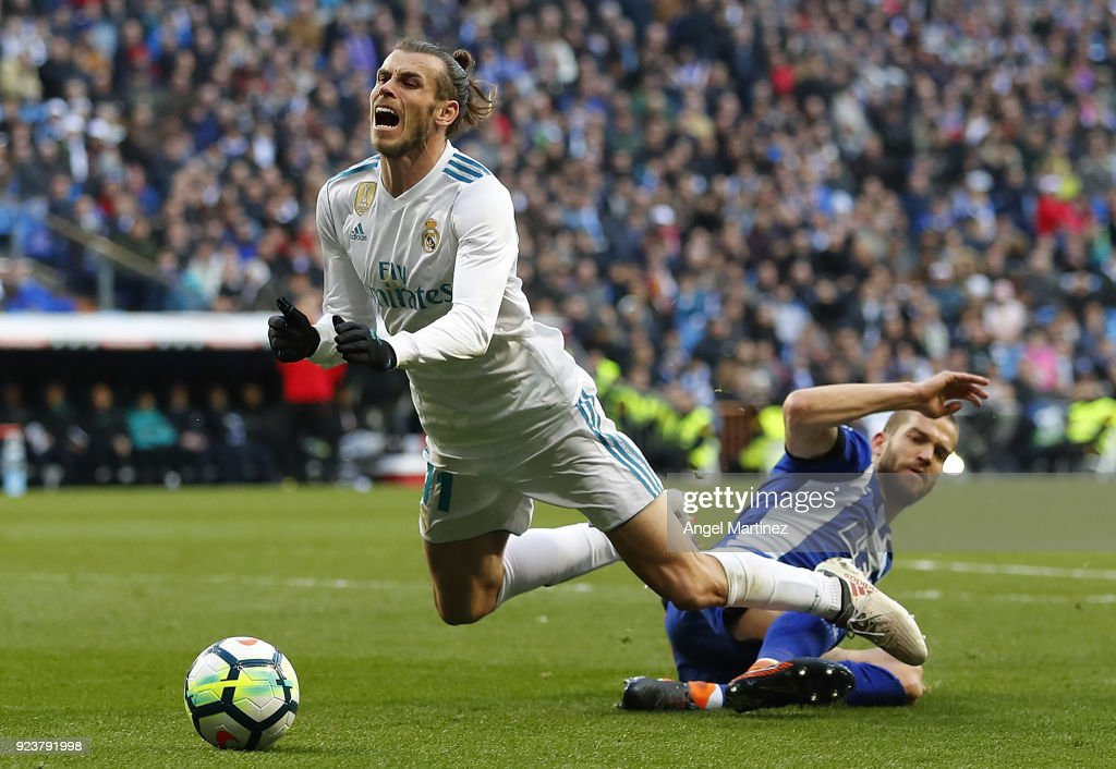 Gareth Bale of Real Madrid is fouled in penalty area by Victor Laguardia of Deportivo Alaves during the La Liga match between Real Madrid and Deportivo Alaves at Estadio Santiago Bernabeu on February 24, 2018 in Madrid, Spain.