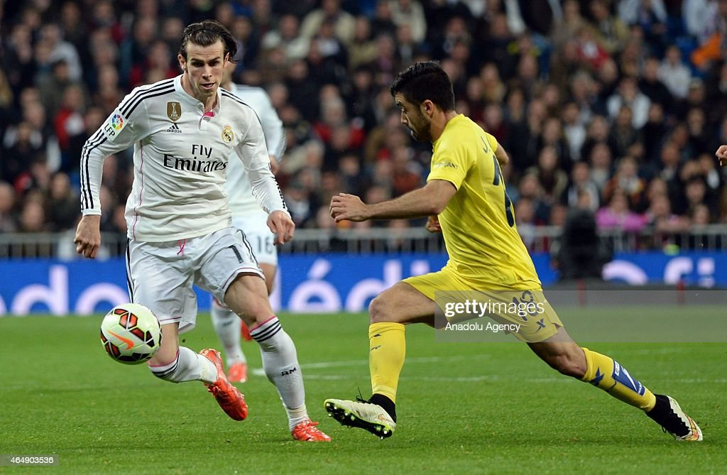Gareth Bale (L) of Real Madrid is in action against Jaume Costa (R) of Villarreal during the La Liga match between Real Madrid and Villarreal at Estadio Santiago Bernabeu in Madrid, Spain on March 1, 2015.