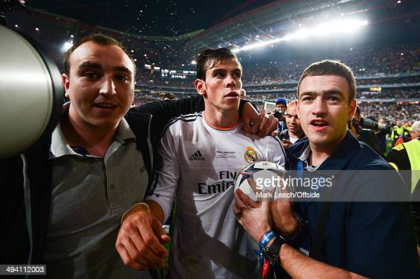 Gareth Bale of Real Madrid is surrounded by fans during the UEFA Champions League Final between Real Madrid and Atletico de Madrid at Estadio da Luz...