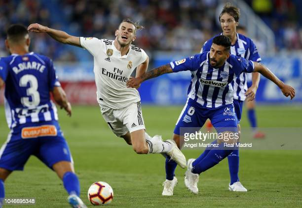 Gareth Bale of Real Madrid is tackled by Guillermo Maripan of Deportivo Alaves during the La Liga match between Deportivo Alaves and Real Madrid at...