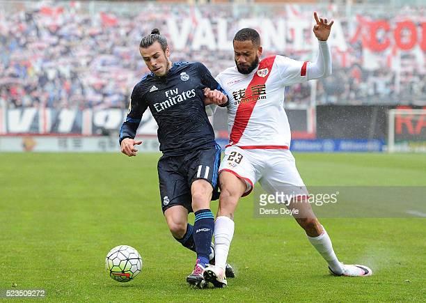 Gareth Bale of Real Madrid is tackled by Tiago Manuel Dias Correia 'Bebe' of Rayo Vallecano de Madrid during the La Liga match between Rayo Vallecano...