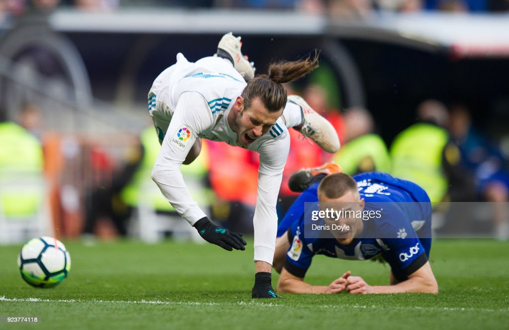 Gareth Bale of Real Madrid is taken down by Rodrigo Ely of Deportivo Alaves during the La Liga match between Real Madrid and Deportivo Alaves at Estadio Santiago Bernabeu on February 24, 2018 in Madrid, Spain.