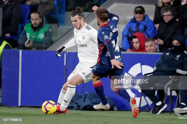 Gareth Bale of Real Madrid Jorge Miramon of SD Huesca during the La Liga Santander match between SD Huesca v Real Madrid at the Estadio El Alcoraz on...