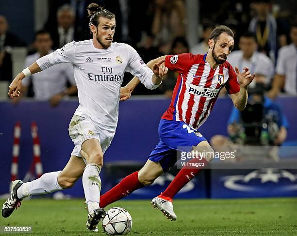 Gareth Bale of Real Madrid Juanfran of Atletico Madrid during the UEFA Champions League final match between Real Madrid and Atletico Madrid on May 28...