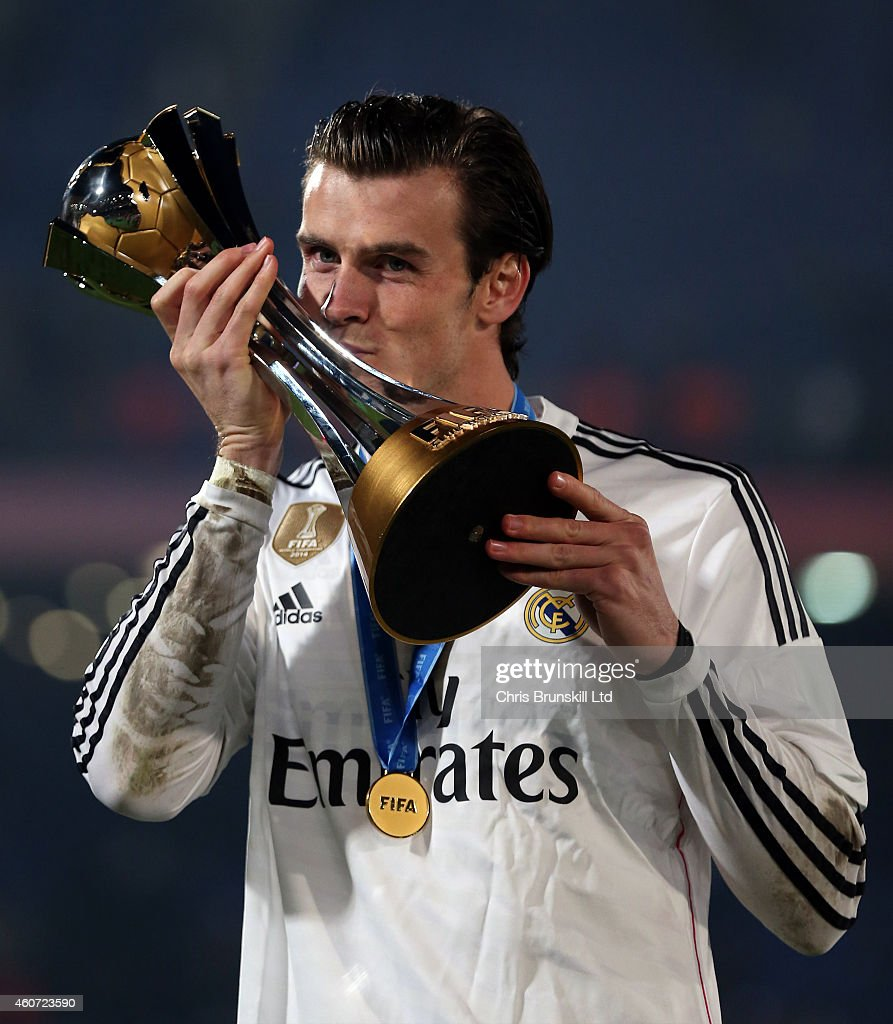 Gareth Bale of Real Madrid kisses the trophy following the FIFA Club World Cup Final match between Real Madrid CF and San Lorenzo at Marrakech Stadium on December 20, 2014 in Marrakech, Morocco.