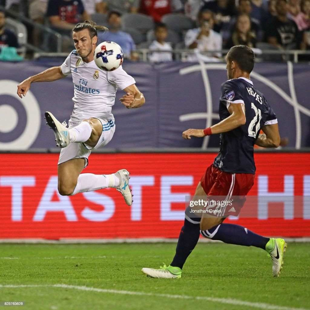 Gareth Bale #11 of Real Madrid leaps to pass around Matt Hedges #21 of the MLS All-Stars during the 2017 MLS All- Star Game at Soldier Field on August 2, 2017 in Chicago, Illinois. Real Madrid defeated the MLS All-Stars 4-2 in a shootout following a 1-1 regulation tie.