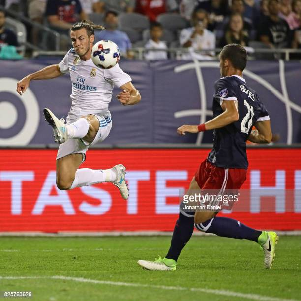 Gareth Bale of Real Madrid leaps to pass around Matt Hedges of the MLS AllStars during the 2017 MLS All Star Game at Soldier Field on August 2 2017...