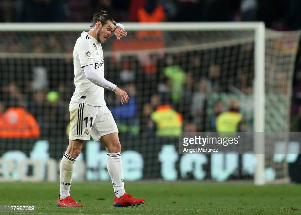 Gareth Bale of Real Madrid leaves the pitch at the end of the Copa del Rey Semi Final match between FC Barcelona and Real Madrid at Nou Camp on...