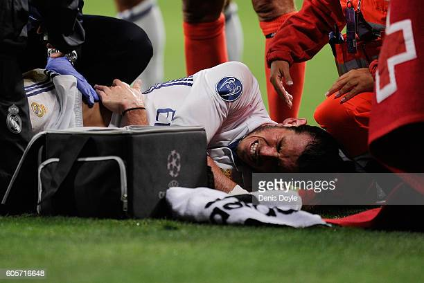 Gareth Bale of Real Madrid lies injured after colliding with Sebastian Coates of Sporting Clube de Portugal during the UEFA Champions League Group F...